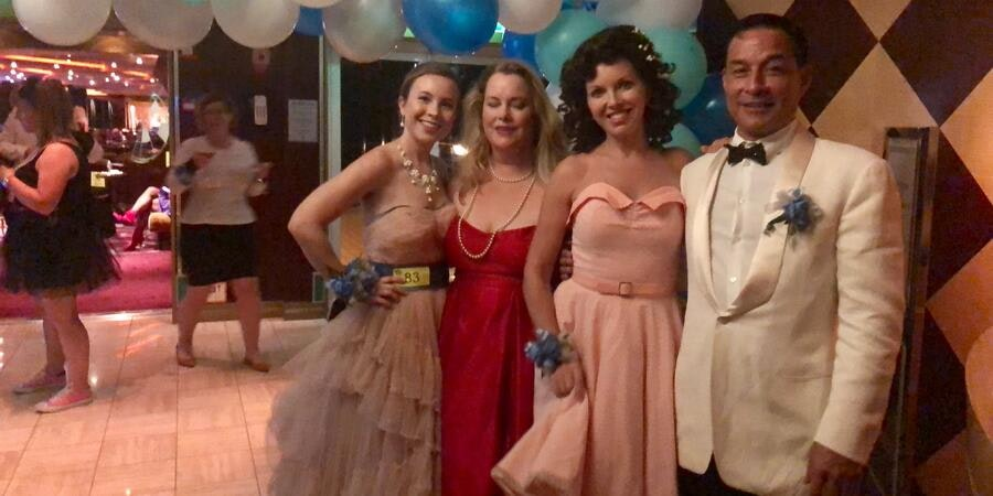 Cruisers dressed for the 80's Cruise Prom (Photo: Chris Gray Faust)