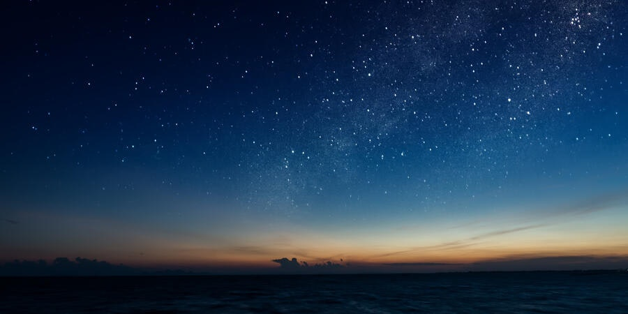 Stargazing at sea (Photo: NOPPHARAT STUDIO 969/Shutterstock.com)