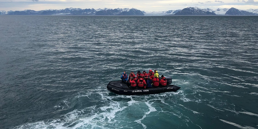 Tauck Travel passengers, traveling on Ponant's Le Boreal, set off on a Zodiac glacier excursion (Photo: Chris Gray Faust)