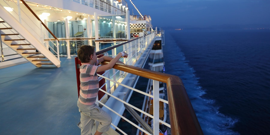 Child on a cruise ship at night (Photo: Pavel L Photo and Video/Shutterstock.com)