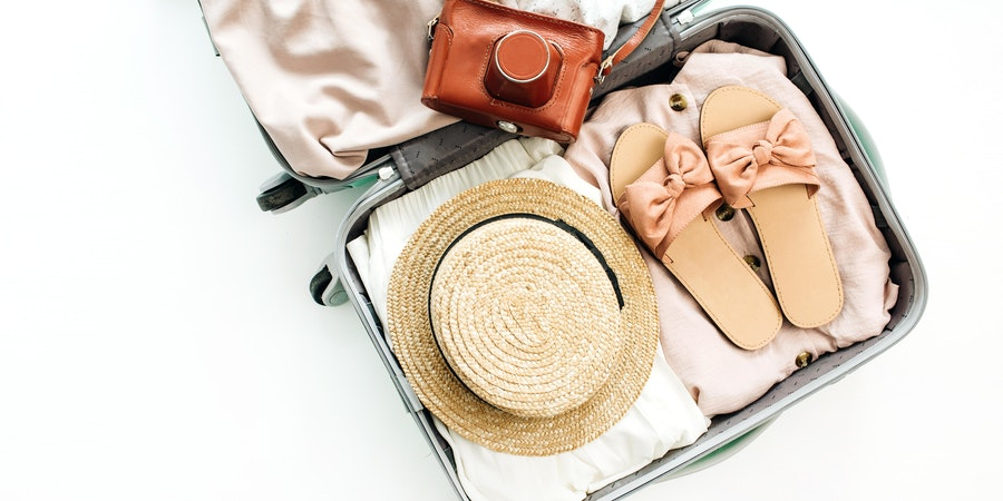 Luggage With Belongings Stored Inside (Photo: Floral Deco/Shutterstock)