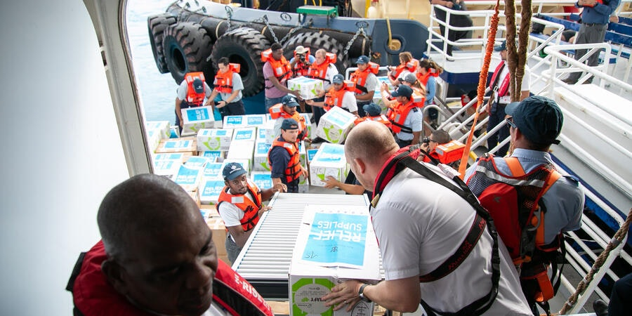 Symphony of the Seas' crew members unloading relief supplies and meals for distribution at Grand Bahama (Photo: Royal Caribbean)