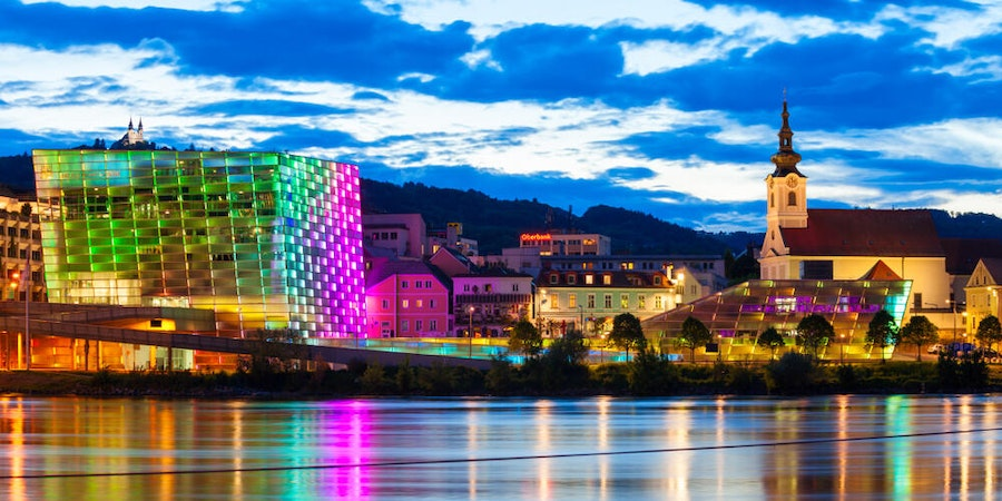In Linz, evening light shows at the futuristic Ars Electronica Center are amazing. (Photo via Shutterstock)