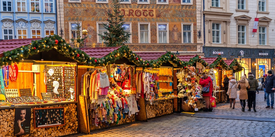 Wooden booths offering souvenirs during Christmas Market in Prague, Czech Republic (Photo: Rostislav Glinsky/Shutterstock)