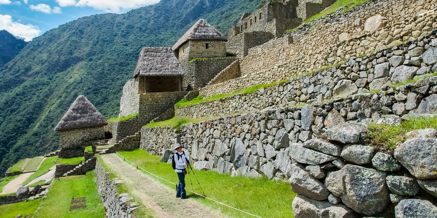 Tourist exploring Mach Picchu (Photo: Marc Belair/Shutterstock)