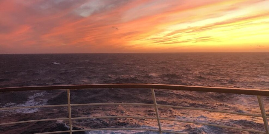 Sunset from the Penthouse Suite balcony on Seven Seas Voyager (Photo: johnsva0511/Cruise Critic member)