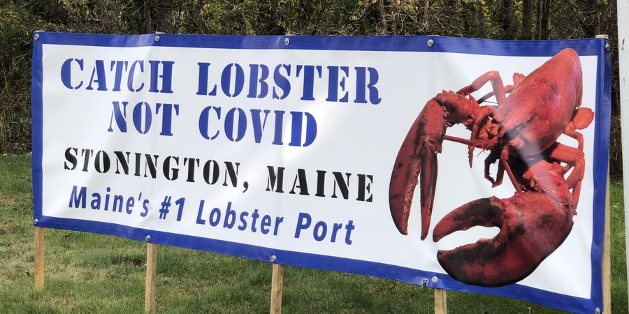 COVID sign in Stonington, Maine (Photo: Chris Gray Faust/Cruise Critic)
