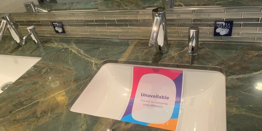 Social distancing sign in the public restrooms on Quantum of the Seas (Photo: masteradept/Cruise Critic member)