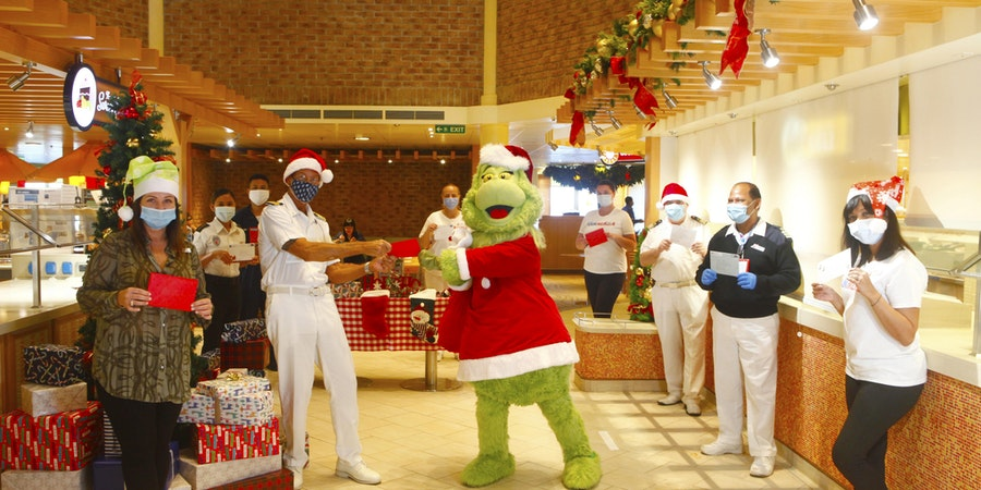 Grinch Delivers Holiday Cards to Carnival Cruise Ship Crew Around The World