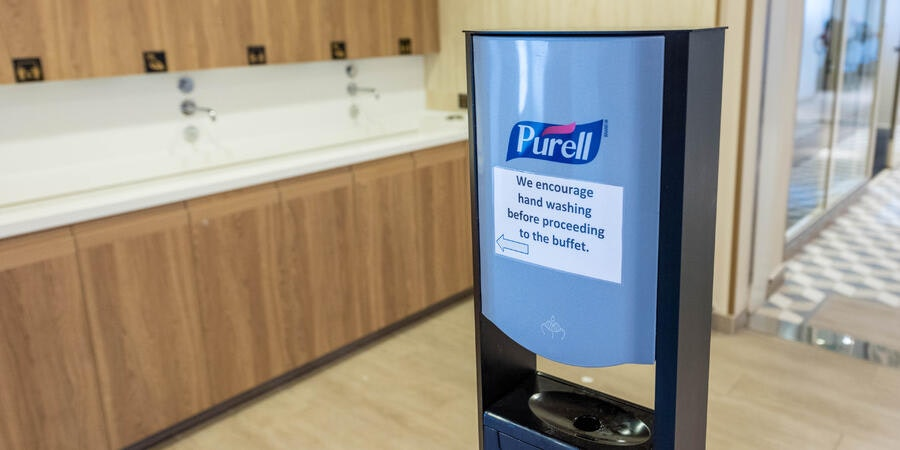 Hand-washing and sanitizing station outside of the cruise ship buffet (Photo: Cruise Critic)