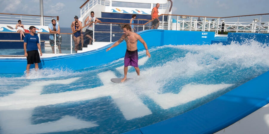 Amateur surfer putting on a show on Freedom of the Seas' Flowrider (Photo: Cruise Critic)