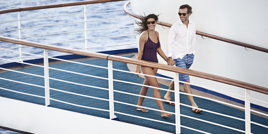 Couple walking the sun deck onboard Princess (Photo: Princess Cruises)