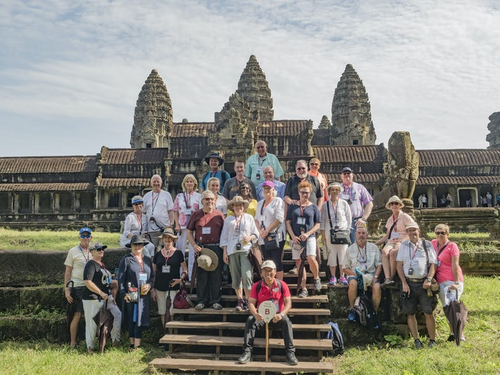 Tour group enjoying the ruins in Cambodia.