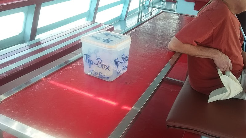 tip box that is shoved in your face on disembarkation from tender to Koh Sa